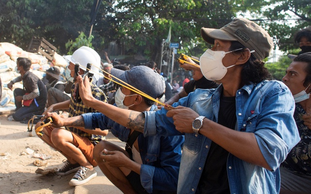 Myanmar's protesters face down the military with slingshots and rocks