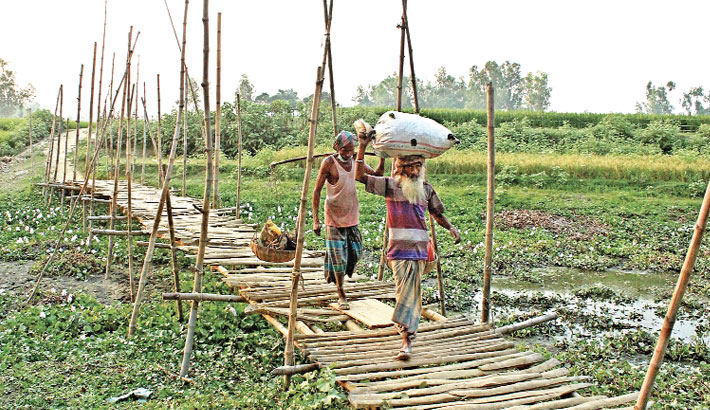A bamboo bridge over a cannel amid the scorching summer heat