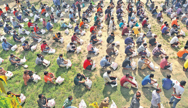 Distributes relief among low-income people at Kazem Ali School ground