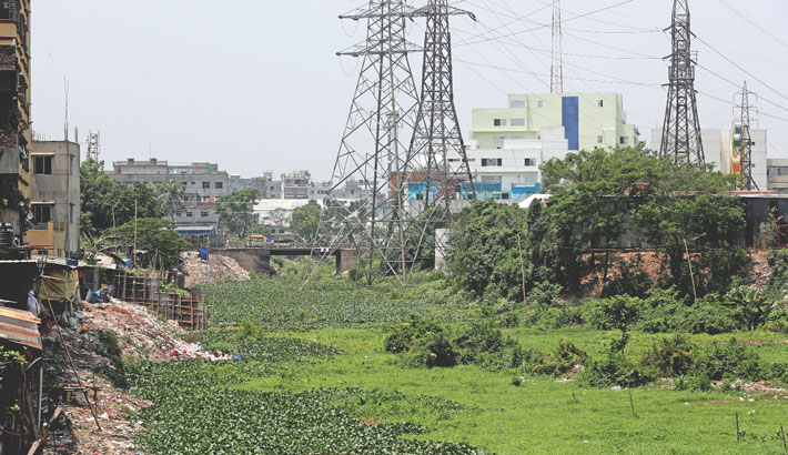 The 'adi' channel of the Buriganga River is gradually being filled up