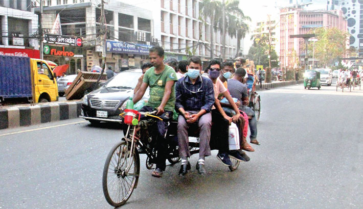 Some office-goers hire a rickshaw-van to reach their destinations due to the absence of public transports