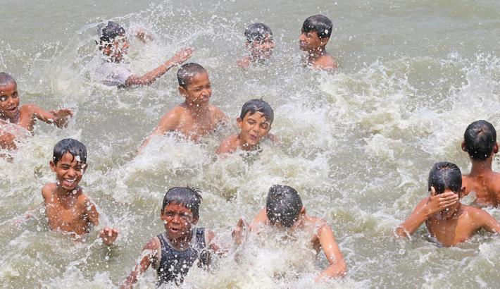 Children are taking a fun bath in a pond