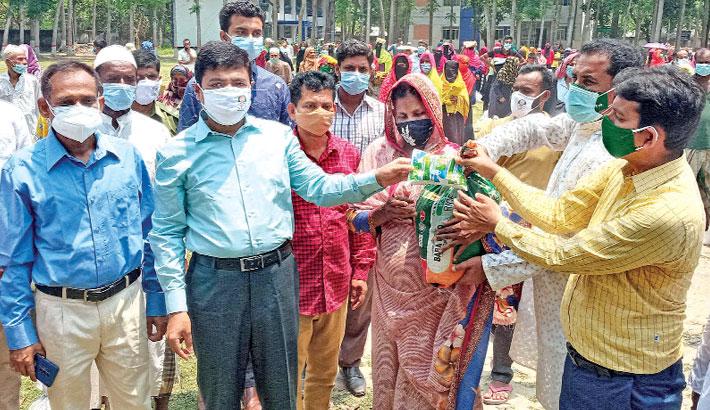 Hands over relief materials among the lockdown-hit poor people