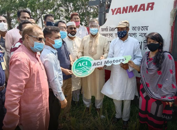 Hasan hands over combined harvester machines to Rangunia farmers