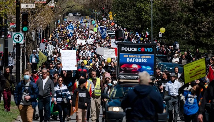 Thousands march in Montreal against virus restrictions