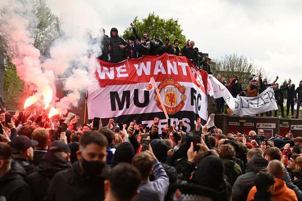 Man United v Liverpool match postponed after fans storm pitch