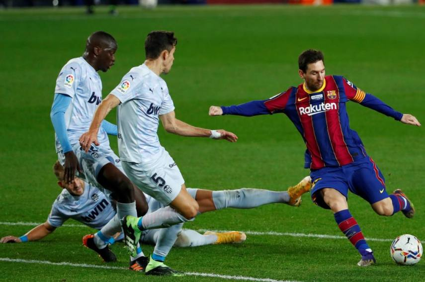 Messi double leads Barca to nail-biting win over Valencia