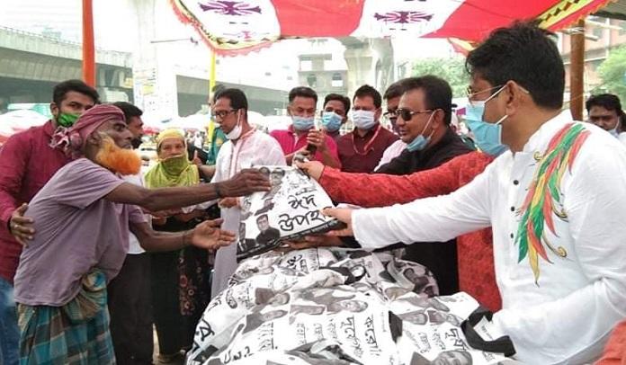 Swechasebak League distributes Eid gifts among poor families in Jatrabari