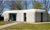 Dutch couple moves into one of the world's first 3D-printed houses