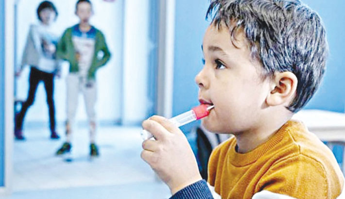 With 'lollipops', Austria tests toddlers for virus