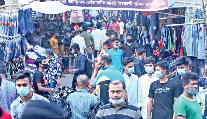 Thousands throng roadside shops to buy Eid clothing and gifts for themselves and their loved ones