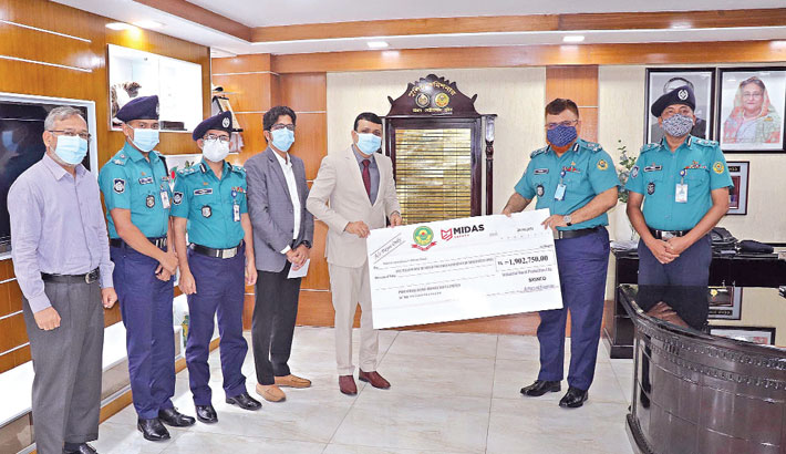 Hands over a cheque for Tk 1.9 million