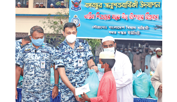 BAF personnel hand over food items and Eid gifts