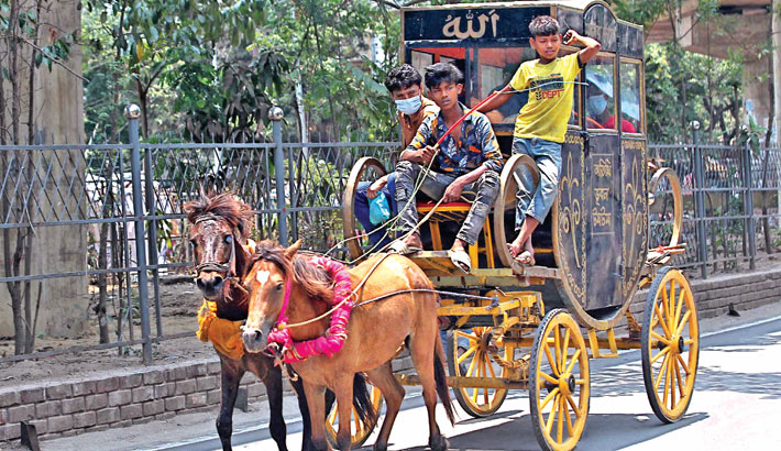 Sharing the road with buses, rickshaws and other vehicles