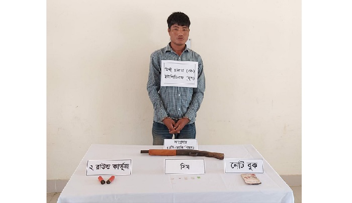 Armed member of the UPDF (Prasit) group held during an army operation in Rangamati