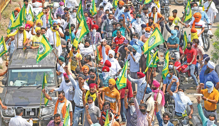 Farmers take part in a protest march against the weekend lockdown