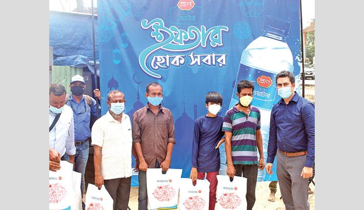 PRAN Drinking Water distributes food among poor people