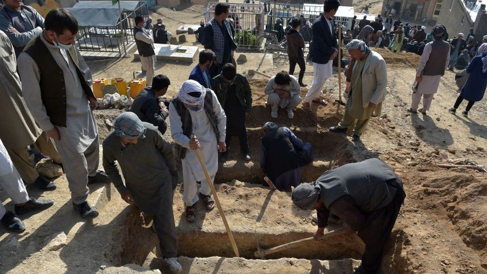 Afghan children buried as attack toll rises to 60