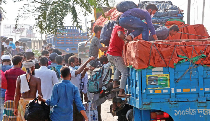 Desperate people are boarding a goods-laden truck to go home ahead of Eid-ul-Fitr