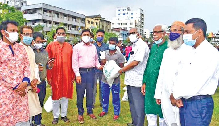 Hands over relief materials among the lockdown-hit poor people at a programme held