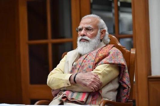 Indian Prime Minister Narendra Modi greets people on Eid