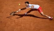 Ex-Rome winners Nadal, Djokovic, Zverev through to last eight as fans return