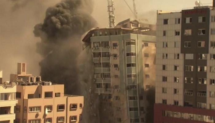 Israel strike in Gaza destroys building with AP, Al Jazeera