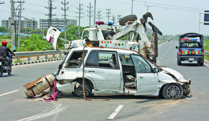 A police tow truck salvages a badly-damaged car which turns turtle on Dhaka-Mawa Expressway