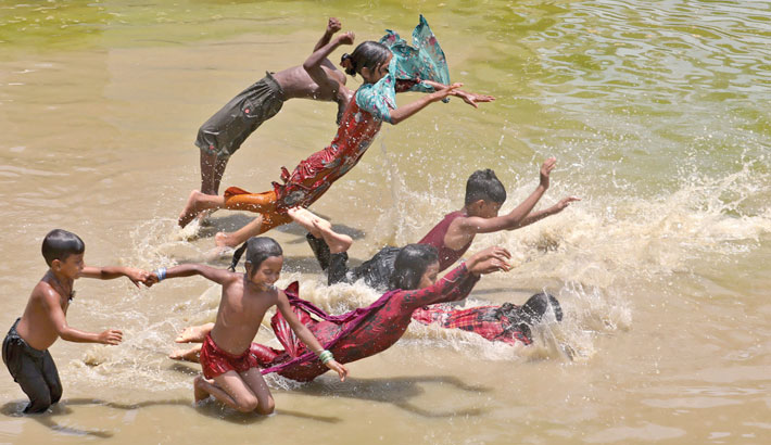 Amid scorching summer heat, children are taking a fun bath in the Karnaphuli River to cool off