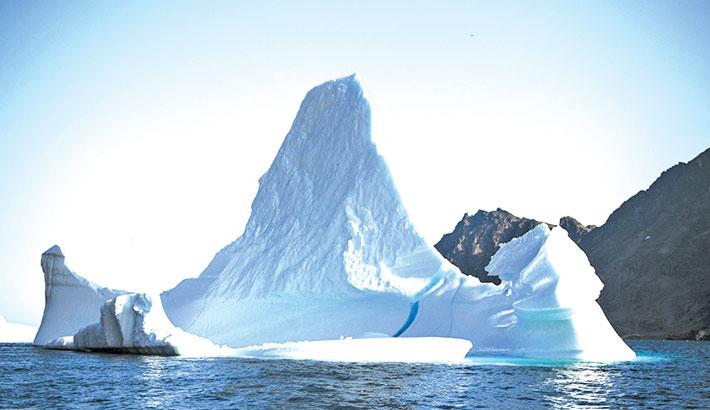 Changing snowfall making Greenland darker, warmer