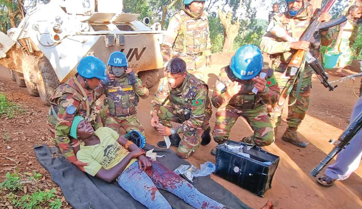 Bangladesh Army engaged in UN peacekeeping mission treat an injured resident