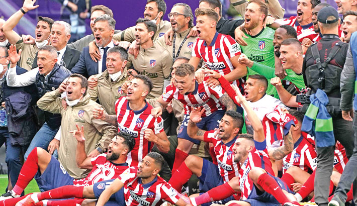 Atletico Madrid players celebrate after winning