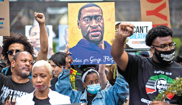 Family, supporters march to mark 1st anniv of George Floyd death