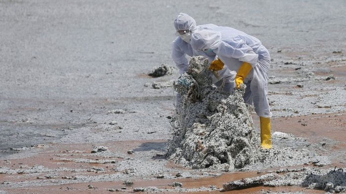 Burning ship coats beaches in oil and debris