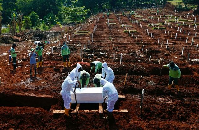 Global Covid deaths top 3.5 million