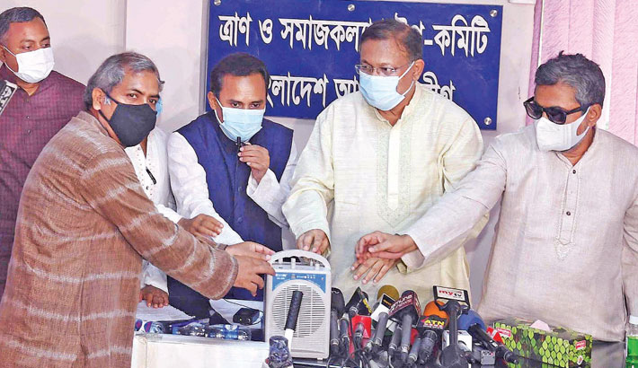 Information Minister Dr Hasan Mahmud hands over protective equipment for Covid-19 to a leader