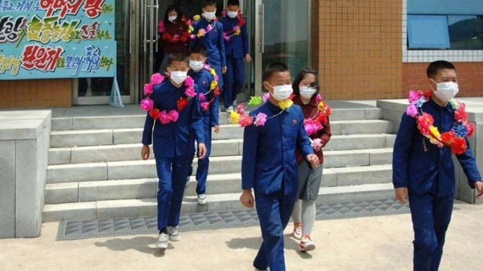 North Korea says children volunteering on mines and farms