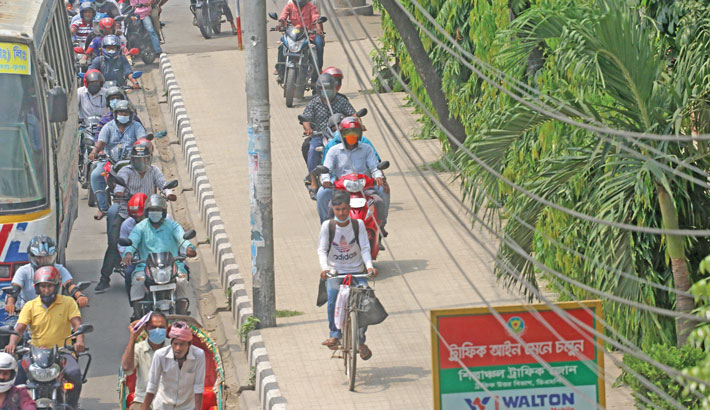 A footpath right by a signboard set up by traffic police urging all to abide by traffic rules