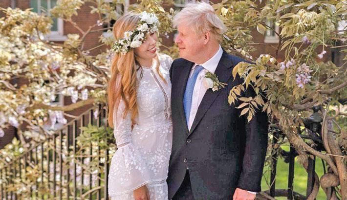 Johnson weds fiancee in 'secret' ceremony