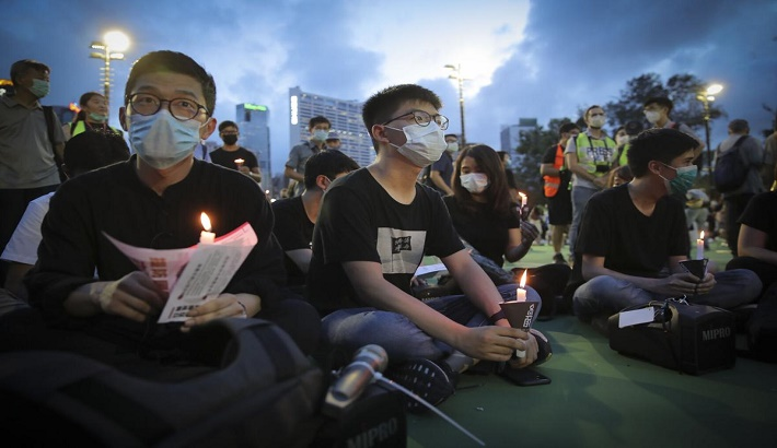Hong Kong political crackdown continues with more prison time for pro-democracy activists, second Tiananmen vigil ban