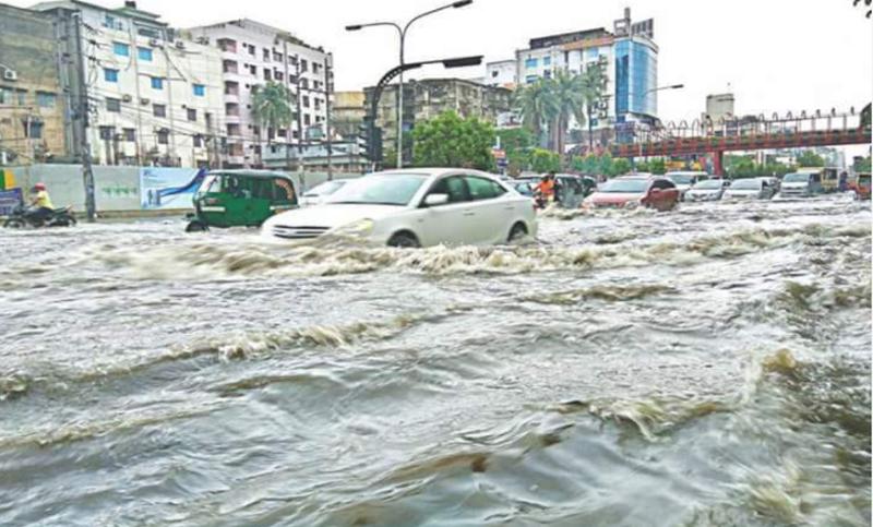 Heavy rain lashes Dhaka, cripples normal life