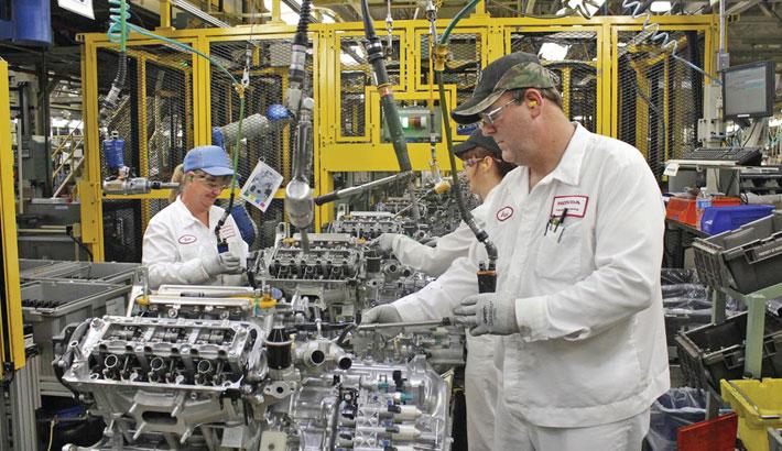 Japan's factory output extends gains