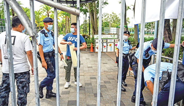 Police close and secure the gates to Victoria Park of Hong Kong