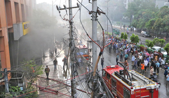 Smoke billows out of a building at Kakrail