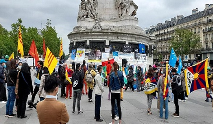 Asian, African dissidents hold protests in Paris against China