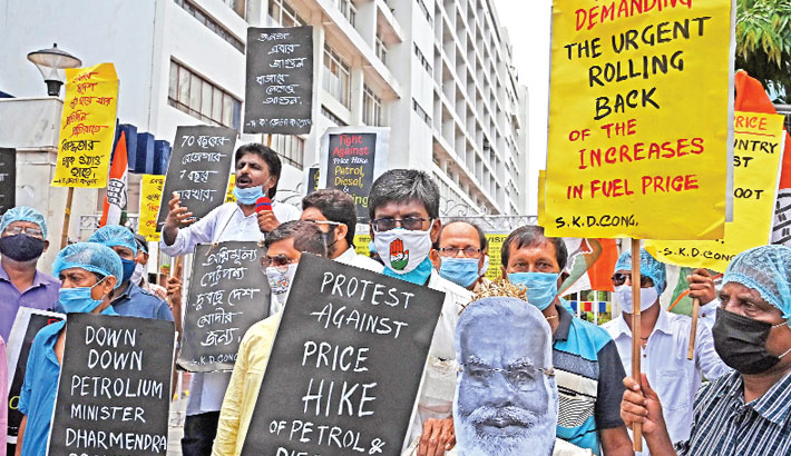 Activists from the Congress party carry an effigy of Indian Prime Minister