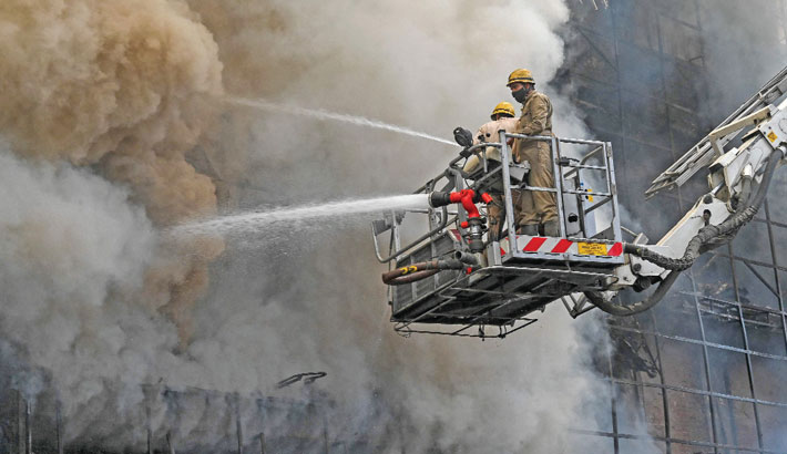 Firefighters tackle a blaze that broke out at a building