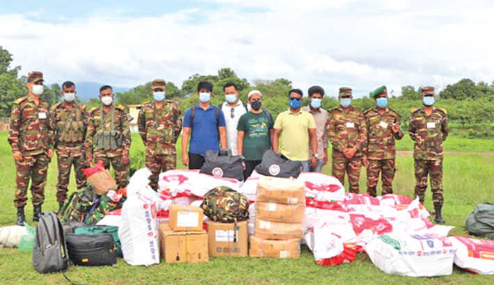 Army pose with medical aid which will be provided to people suffering