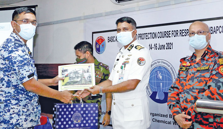 Armed Forces Division's Civil Military Relations (CMR) Director General Commodore Arif Ahmed Mustafa hands over a certificate to a participant of a course titled 'Rescue operations after chemical-fed disasters and its management' at a training workshop in the capital on Wednesday.