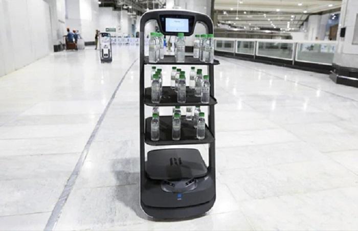 Socially distanced robots serve Mecca holy water ahead of Hajj